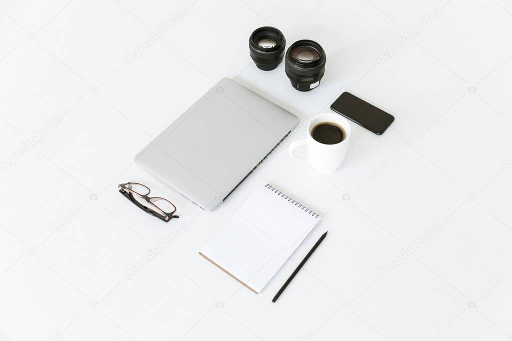 composition with laptop and camera lenses