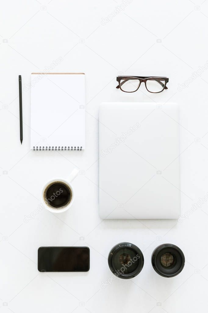 Flat lay with laptop and workplace items