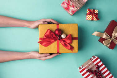 hands holding christmas gift box