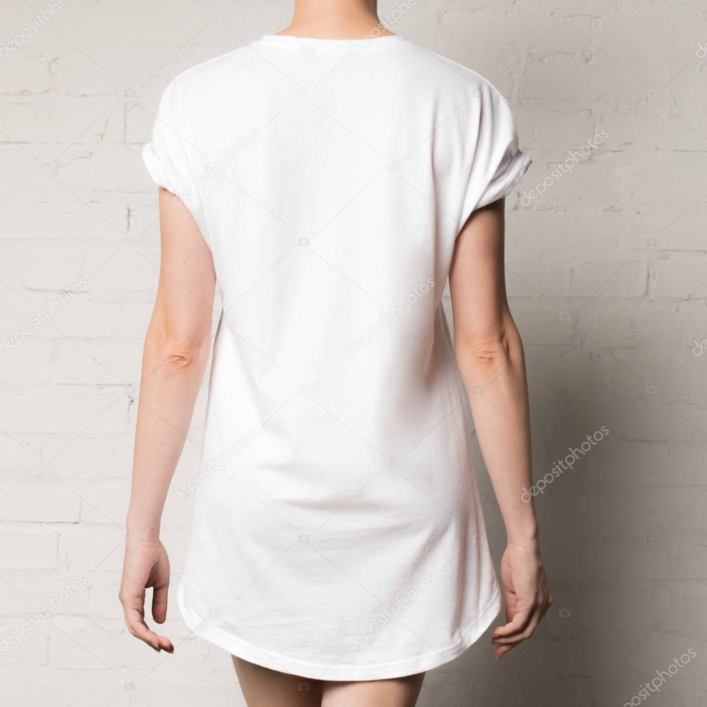 Cropped shot of woman in blank white t-shirt stock vector