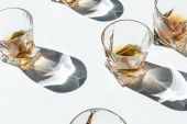 cognac in glasses with shadows