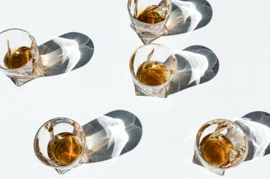 bourbon in glasses with shadows