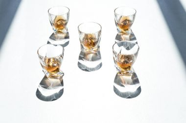 whiskey in glasses with shadows