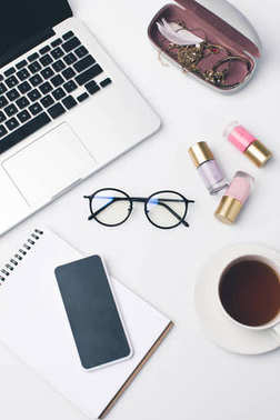 Modern girly workplace with laptop and stylish eyeglasses stock vector