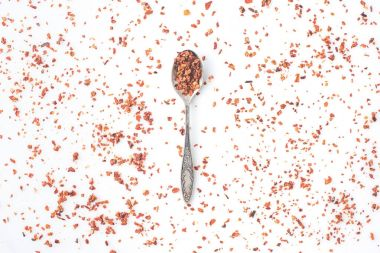 spoon with grated red pepper