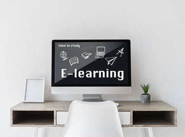 Computer with learning theme on screen