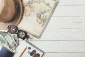 Fotografie travel stuff on white wooden table