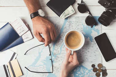 Couple planning travel with map