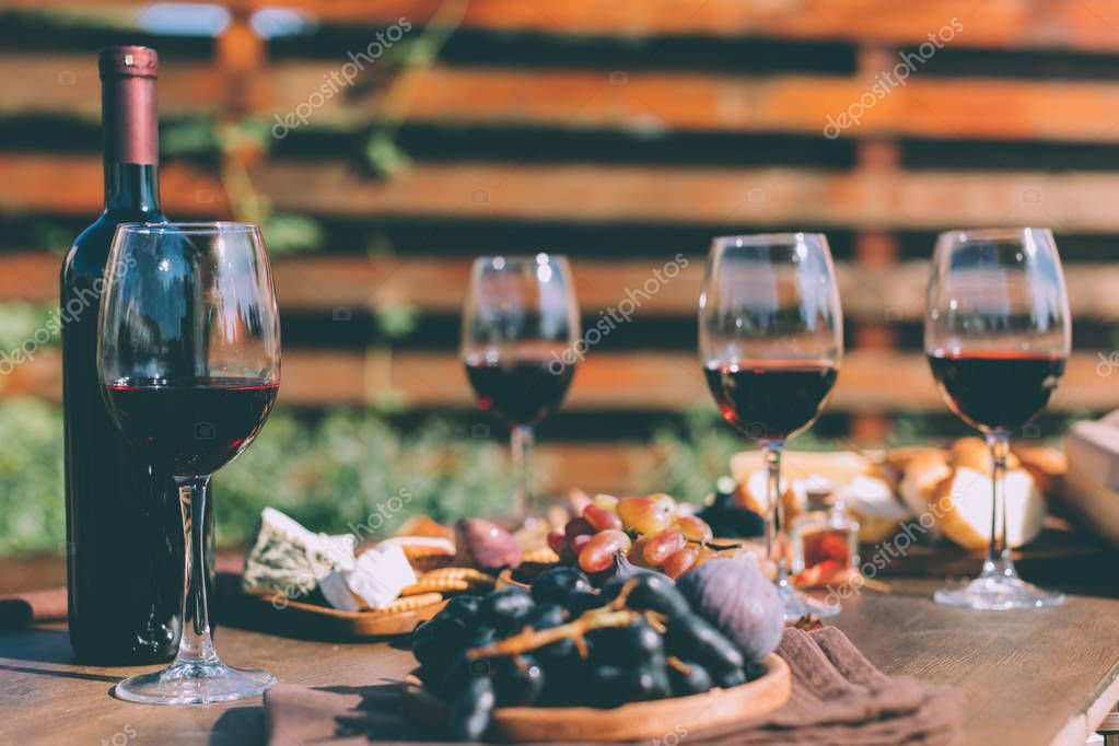 red wine and various snacks