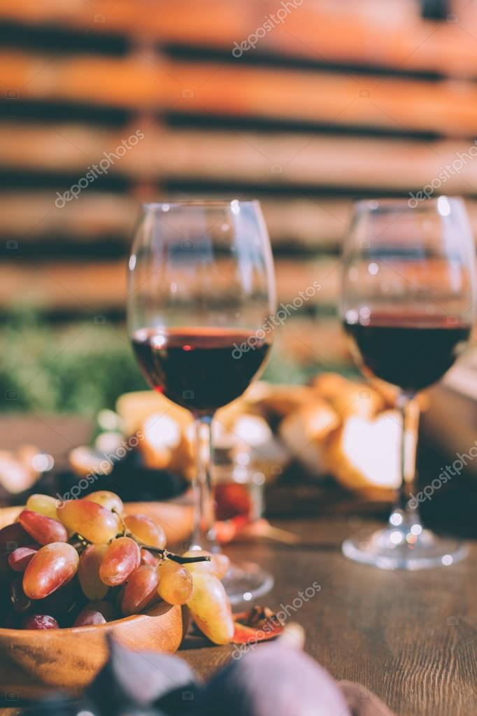 red wine and bowl of grapes