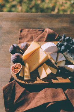 wine snacks on cutting board