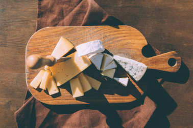 variation of cheese on cutting board