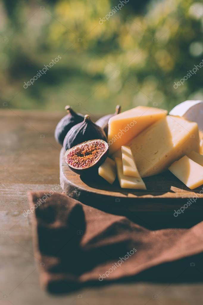 cheese and figs on cutting board