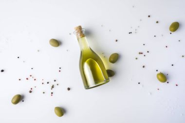 olive oil bottle with cork and olives