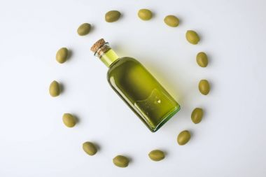 Top view of glass bottle with olive oil inside of olives circle isolated on white stock vector
