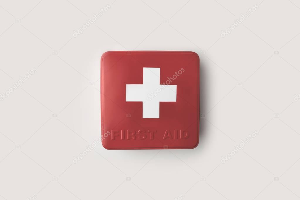 red firs-aid kit with cross
