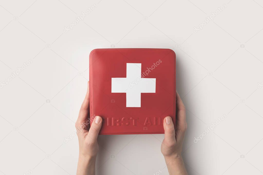 woman holding first-aid kit