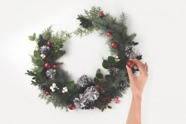 hand making christmas wreath