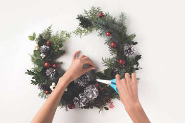 making christmas wreath from fir branches