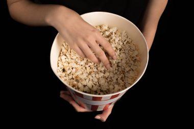 woman wth bucket of popcorn