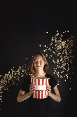 woman with spilling popcorn