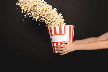 woman holding bucket of popcorn