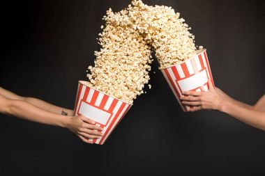 people with buckets of popcorn