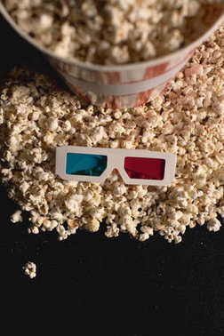 Top view of popcorn with 3d glasses on black stock vector