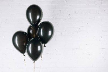 shiny black balloons