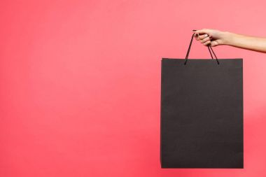 woman holding black shopping bag