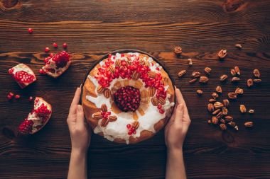 hands with christmas cake