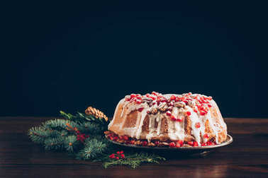 traditional cake and christmas tree branch
