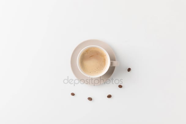 coffee cup with beans around