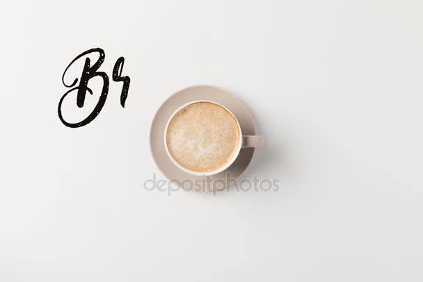 coffee cup with breakfast time lettering