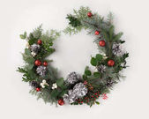 christmas wreath with balls, cones and mistletoe