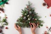 hand making christmas tree