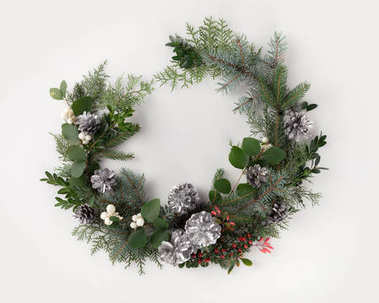 christmas wreath with fir branches and mistletoe