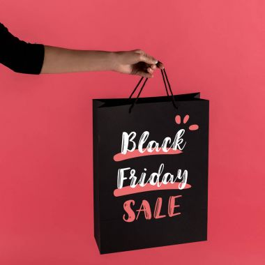 Cropped shot of woman holding black shopping bag isolated on red stock vector