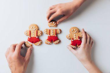 hands with crashed gingerbread men