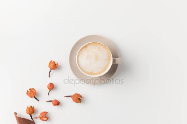 coffee surrounded with flowers and leaves