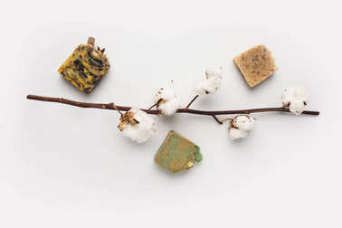 handcrafted soap and cotton branch