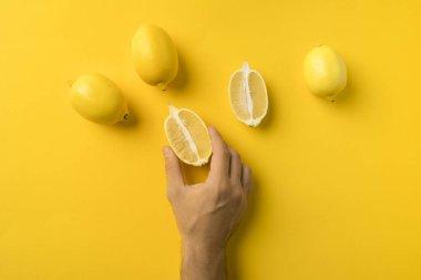 man holding half of lemon