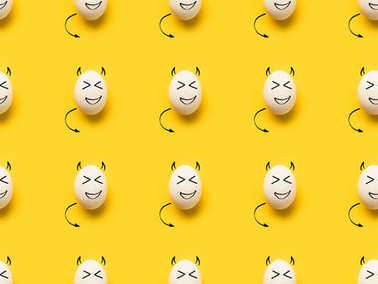 Collection of painted eggs with devils isolated on yellow stock vector