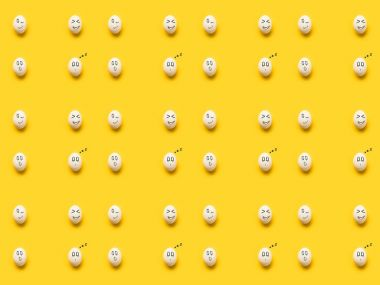 Set of painted eggs with different emotions isolated on yellow stock vector