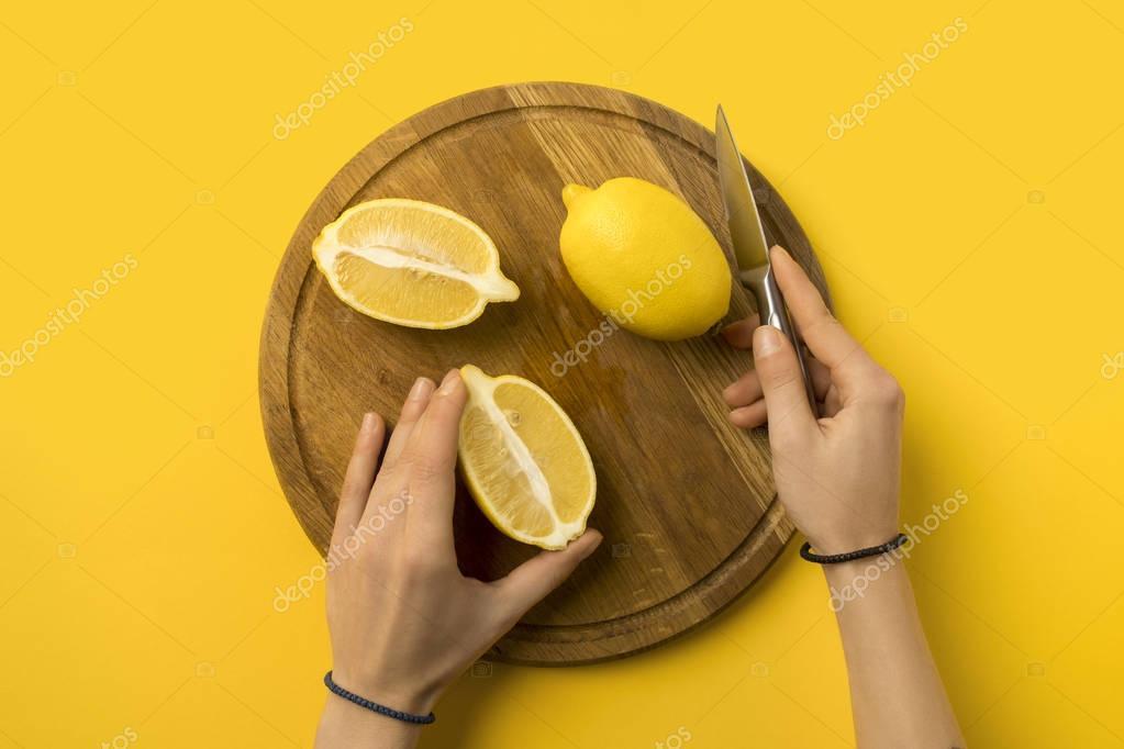 woman cutting lemons