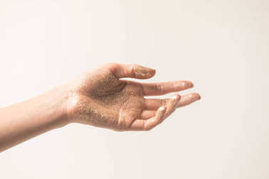 female hand in golden glitter