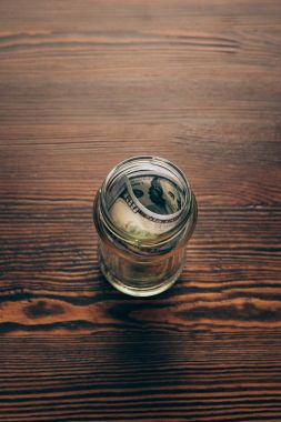 jar with dollar banknotes