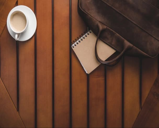 coffee, leather bag and supplies