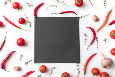 black board among chili peppers