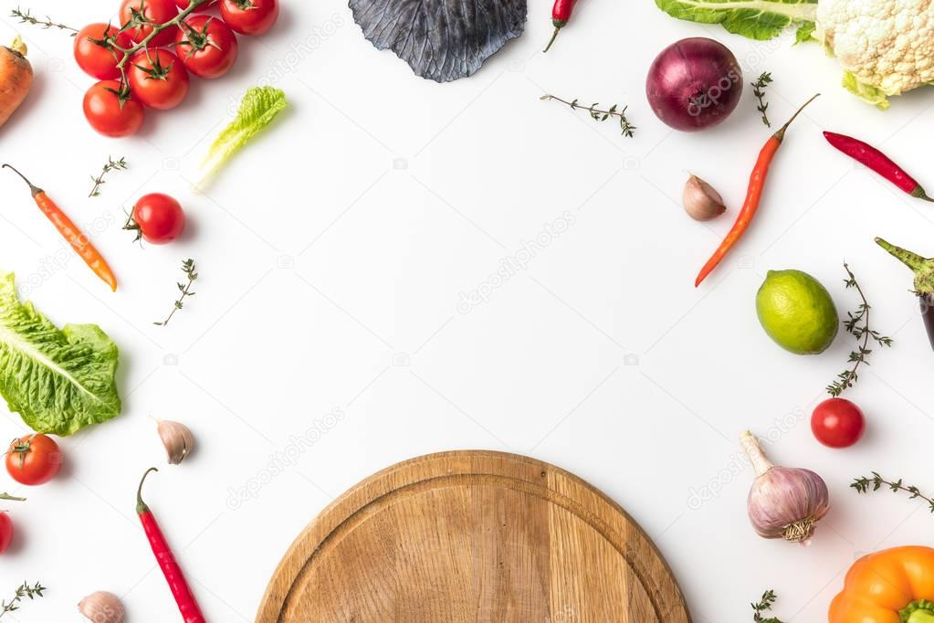 wooden board and unprocessed vegetables